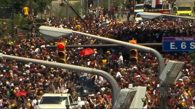 Massive crowd swarms Cleveland for Cavs' parade