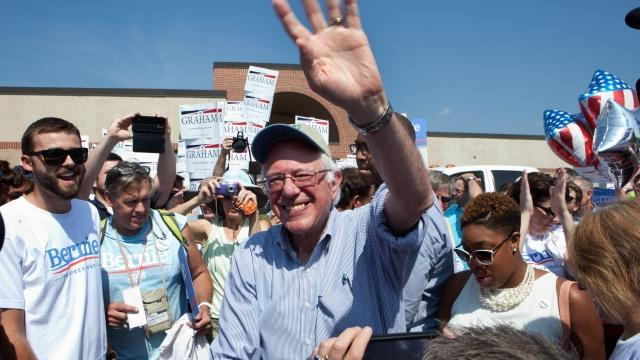 Bernie Sanders says by continuing his campaign, he can convince more people to vote Democrat.