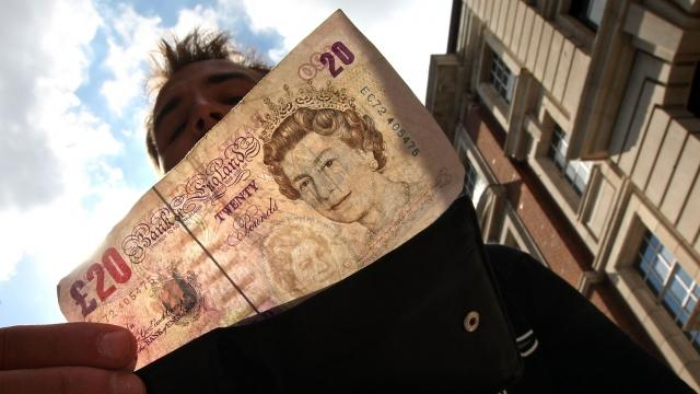 Some places, like banks and hotels, briefly suspended money exchanges involving the pound.