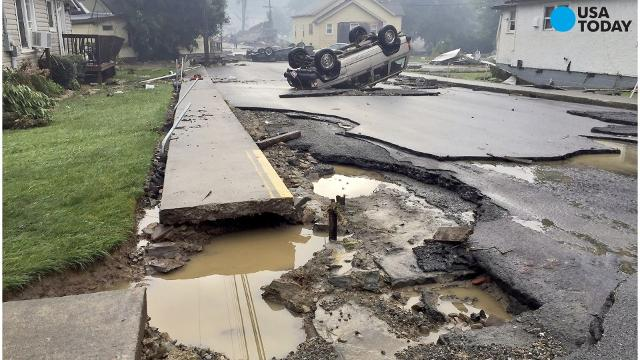 West Virginia floods lead to at least a dozen deaths