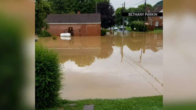 Over a dozen dead in West Virginia flooding, homes damaged
