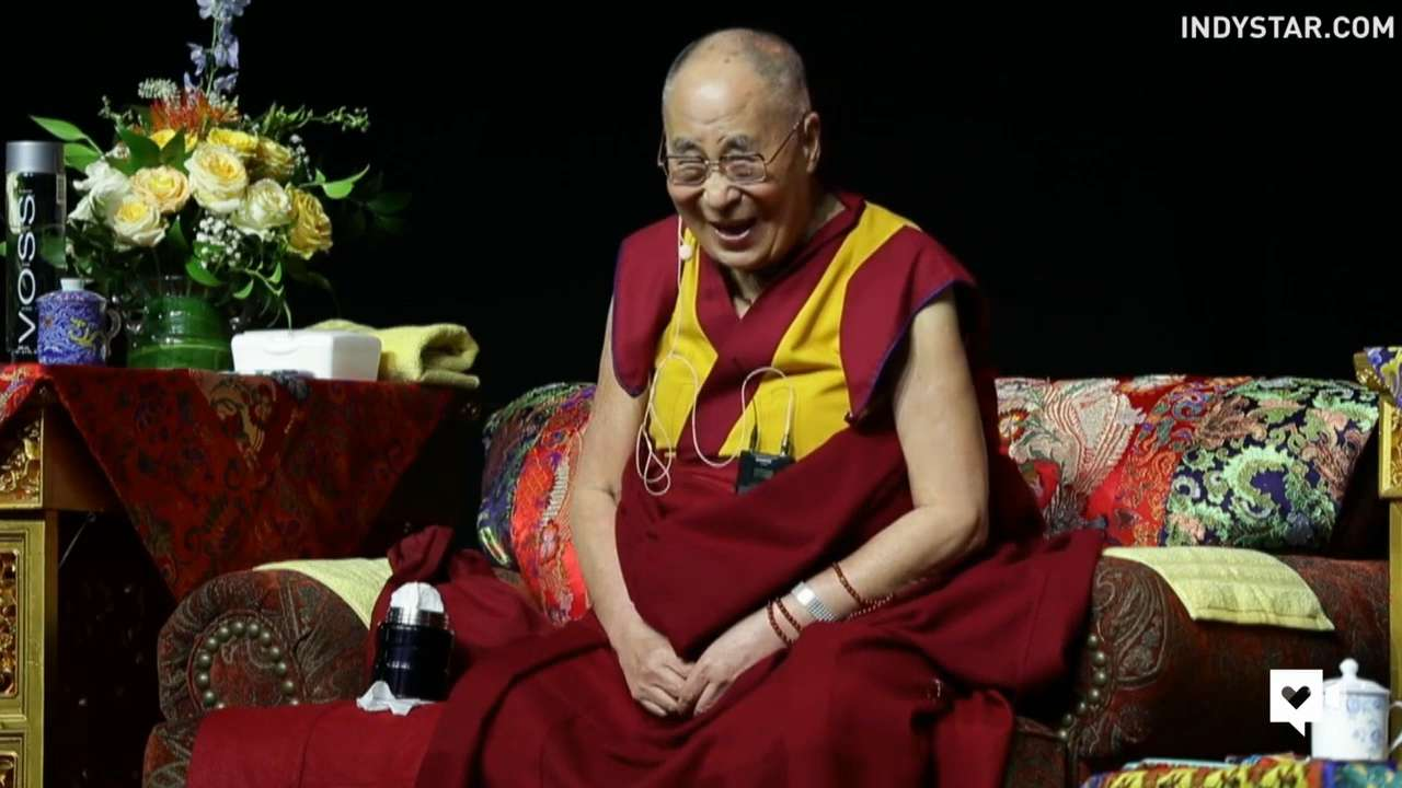 Dalai Lama can't hold in his giggles on stage
