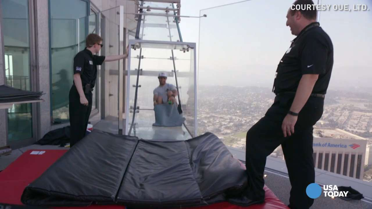 A tweet by CurbedLA that shows the Skyslide, a new attraction on the U.S. Bank Tower in Los Angeles.