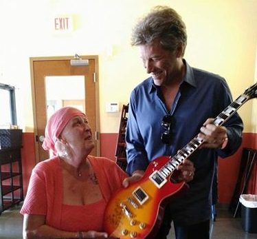 Jon Bon Jovi surprises cancer patient with kiss