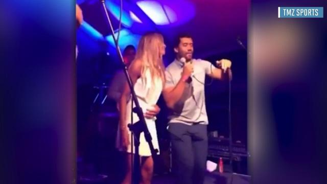 Seattle Seahawks quarterback Russell Wilson does his best Michael Jackson impression for his fiancee Ciara at a charity event.