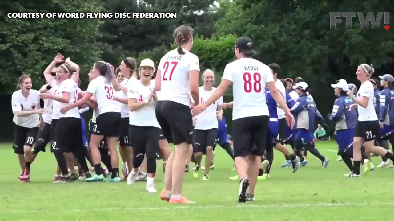 Ultimate Frisbee player makes incredible backwards falling-out-of-bounds throw