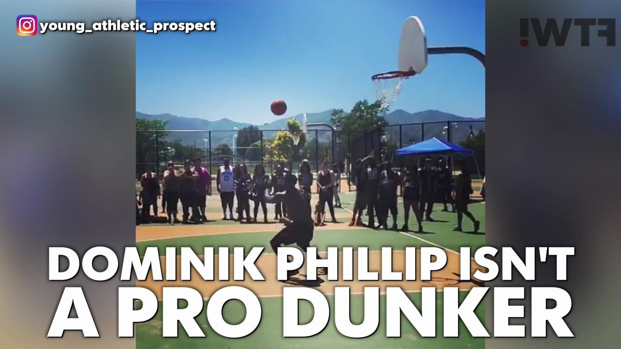 Amateur dunker soars for an alley oop