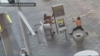 Man attacks people with long pole outside a mall