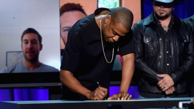 An Apple acquisition would prevent Tidal exclusives that might sway listeners away from Apple Music, plus it could help Apple compete with Spotify.Video provided by Newsy