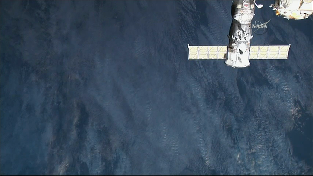 International space station tests docking system for Space station usa