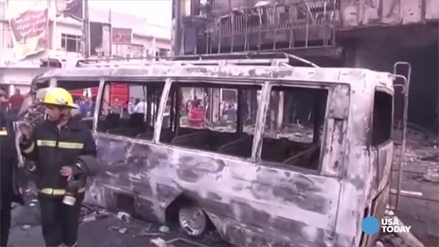 Iraqis gather at the site of suicide car bomb attack