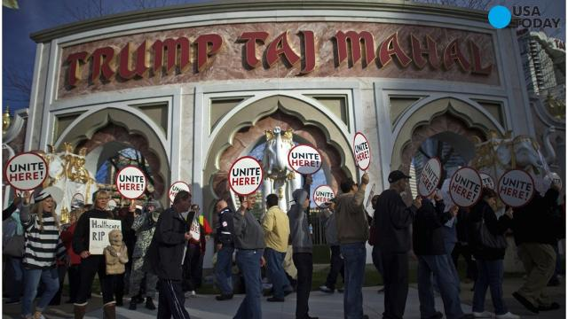 Striking union members picket outside the Trump Taj Mahal casino in Atlantic City, N.J., Sunday, July 3, 2016. The strike by Local 54 of the Unite-HERE union was in its third day with no new talks scheduled.