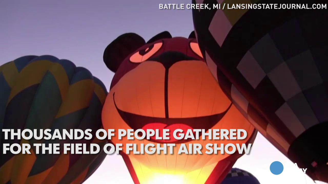 Hot air balloons illuminate skies