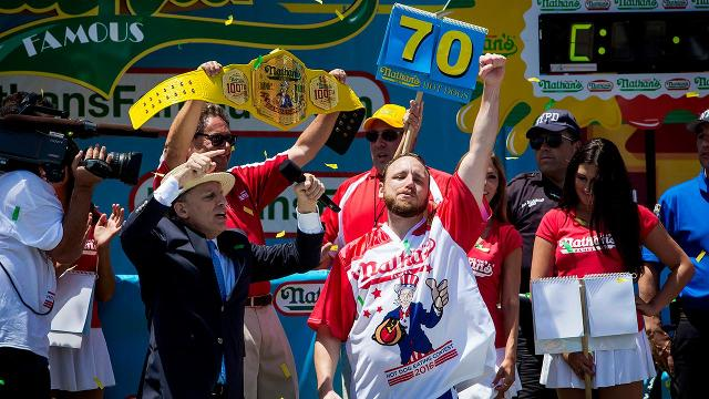 Joey Chestnut Downs 70 Hot Dogs To Reclaim Title