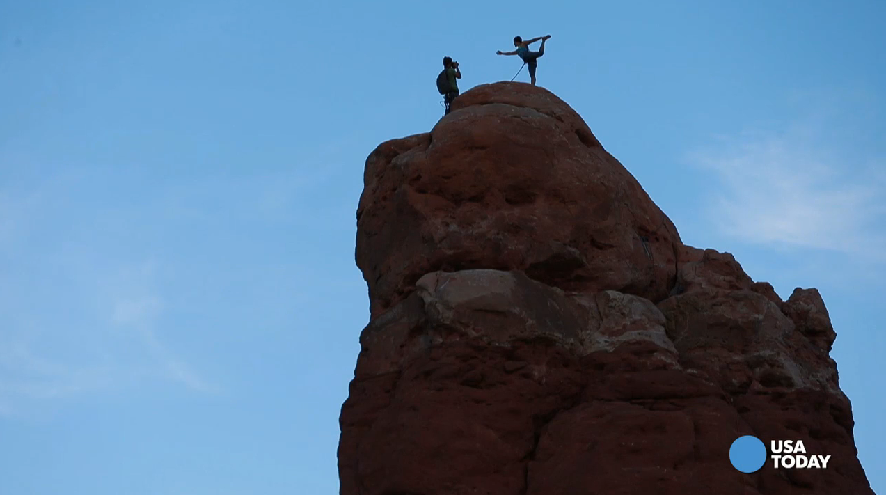 When the sun starts to set at Arches National Park, the rocks look like they're on fire, and it's hard to put your camera down. This adventure photographer takes his camera way up. Video by Patrick Shannahan of The Arizona Republic.