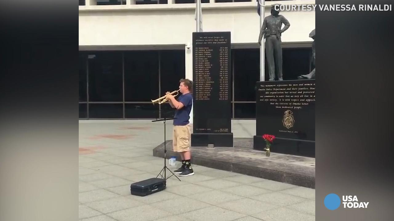 This 14-year-old wanted to do something to honor local police after the police shooting in Dallas. He set up his trumpet at Omaha, Nebraska police headquarters and played taps.