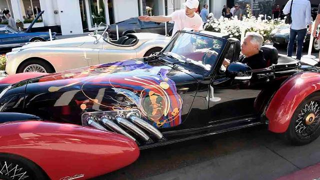USA TODAY's Chris Woodyard talks to Al DiMora about his project of putting artwork on custom cars. Video by Robert Hanashiro, USA TODAY