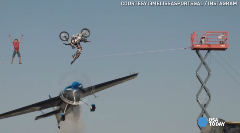 Three adrenaline junkies - an aerobatic pilot, a motocross rider, and a tightrope walker - got together to pull off this insane stunt. You can watch the entire stunt here: http://bit.ly/29zcl6V.