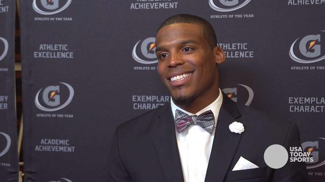 Cam Newton has some fun with a reporter