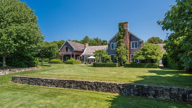 You won't believe the endless amenities (7.5 bathrooms!) of this charming Long Island estate.