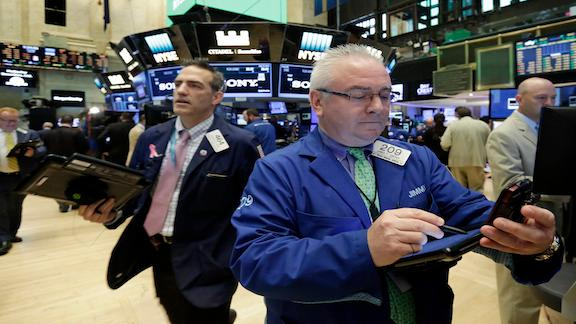 The Dow Jones industrial average and S&P 500 are in record-high territory, boosted by Microsoft profit.