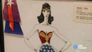 Comic-Con celebrates 75 years of Wonder Woman with a display of costumes from the TV show and the upcoming 'Wonder Woman' movie.