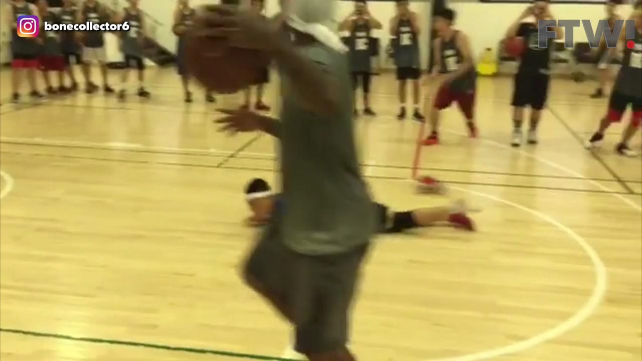 Streetball legend crosses kid right out of his shoes