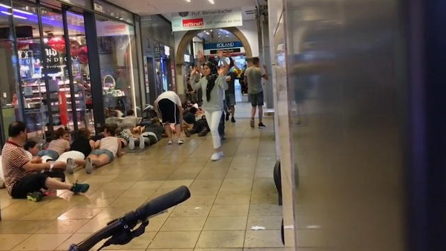 Amateur video obtained by the Associated Press appeared to show the police evacuating a store on Friday inside the Inner City shopping center. This was a separate incident from the attack that killed nine people in the Olympic shopping mall in Munich.  (July 23)