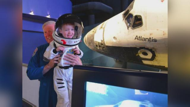 This tiny astronaut finds joy in the universe