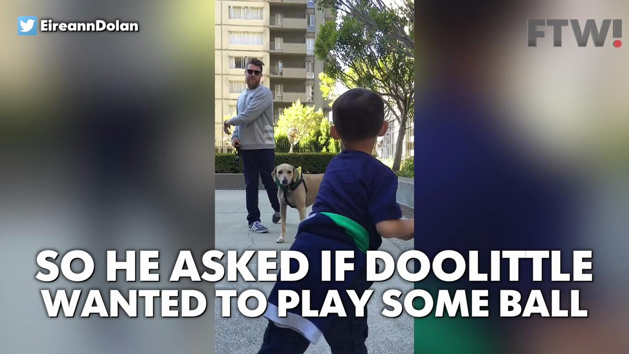 Young fan plays imaginary baseball with A's Sean Doolittle
