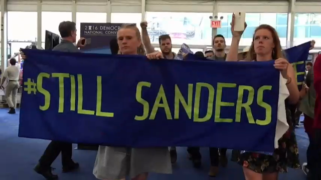 Moments after Hillary Clinton officially won the Democratic nomination for president, a large group of Bernie Sanders' supporters left the convention hall in Philadelphia to hold a sit-in protest at a nearby tent for journalists. (July 26)