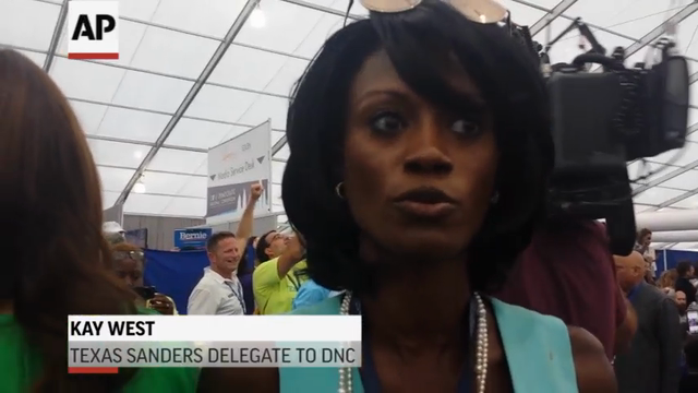 Immediately, after Hillary Clinton became the first woman to claim the presidential nomination of a major U.S. party, Bernie Sanders delegates walked out of the convention center and held about an hour-long sit-in at a media tent. (July 26)