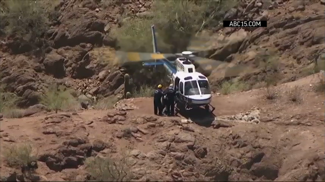 Phoenix, Arizona authorities rescued four hikers off mountains after they suffered heat-related illnesses. Fire Department helicopters were needed to reach some of the hikers. (July 27)