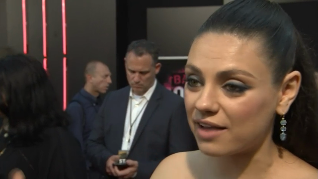 """At the premiere of her latest movie """"Bad Moms,"""" Mila Kunis reveals how she and husband Ashton Kutcher """"high-five each other"""" every night after putting their daughter to bed for surviving another day of parenthood. (July 27)"""