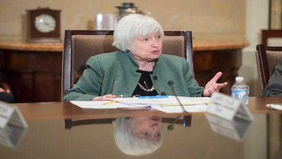 The Federal Reserve kept its key interest rate unchanged Wednesday but provided an upbeat view of the labor market and economy and said risks have diminished, leaving the door open to a September hike.
