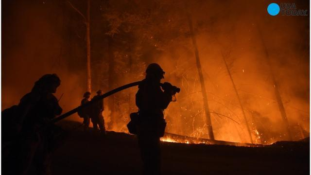 Firefighters Continue To Try And Subdue A Week Old Fire