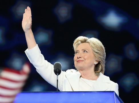 Hillary's white pantsuit symbolized the suffrage movement and created new historic imagery at the Democratic National Convention