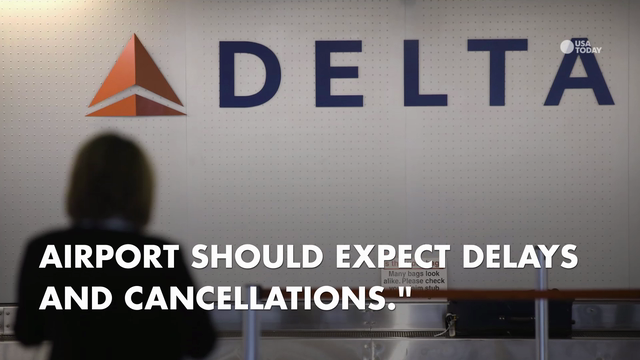 Tens of thousands of people were stranded Monday after Delta Air Lines flights were grounded around the globe due to a system outage.