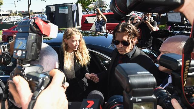 Johnny Depp and Amber Heard have reached a divorce settlement outside of court, just one day before their scheduled restraining order hearing