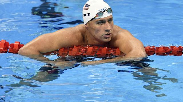 Lochte apologizes for description of gas station incident
