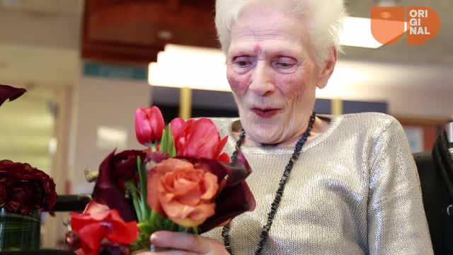 Instead of letting used wedding flowers go to waste, she gives them to people who need some cheering up.