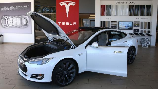 Tesla announced improvements to its Model S, making it faster and extending the charge on its battery, but electric cars are still a tough sell.