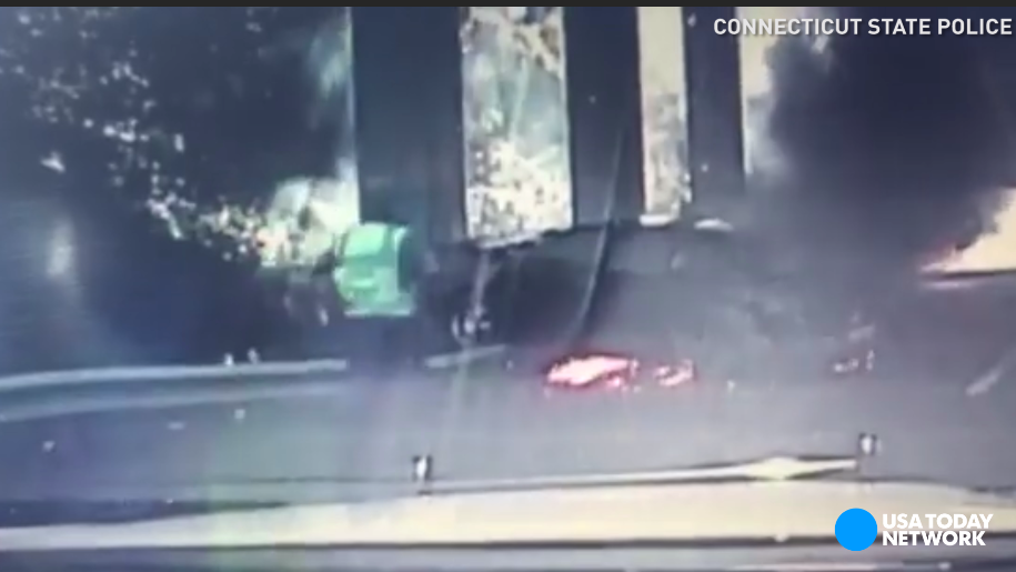 A Connecticut State Trooper witnessed a driver crash into a bridge beam and then the car burst into flames. The trooper, a nearby construction worker and another Good Samaritan rushed over to rescue the man.