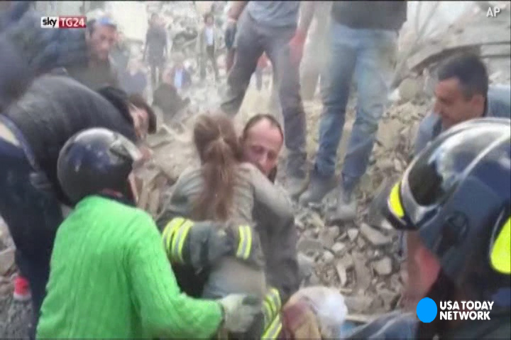 Rescuers cheered when the 10-year-old girl was safely pulled from the rubble in Pescara del Tronto.