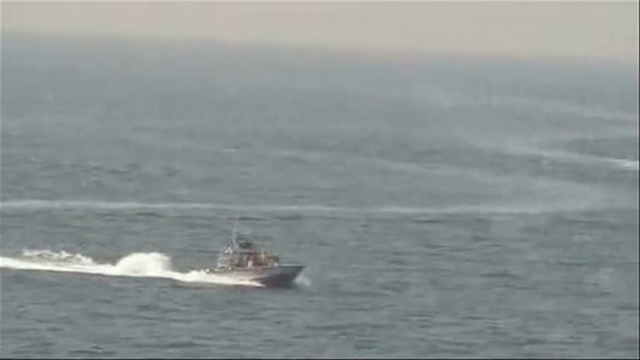Raw: Video Shows Iranian Boats Near US Ship