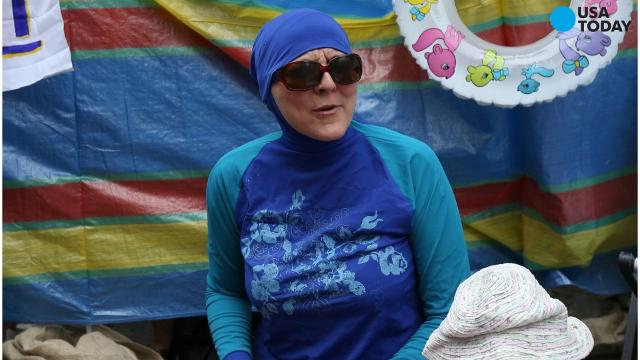 France's highest administrative court suspended its ban on burkini swimsuits Friday after people around the world responded with outrage to the situation that many called racist and Islamaphobic.