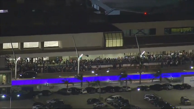 Reports of a gunman opening fire that turned out to be false caused panicked evacuations at Los Angeles International Airport on Sunday night, while flights to and from the airport saw major delays. (Aug. 29)
