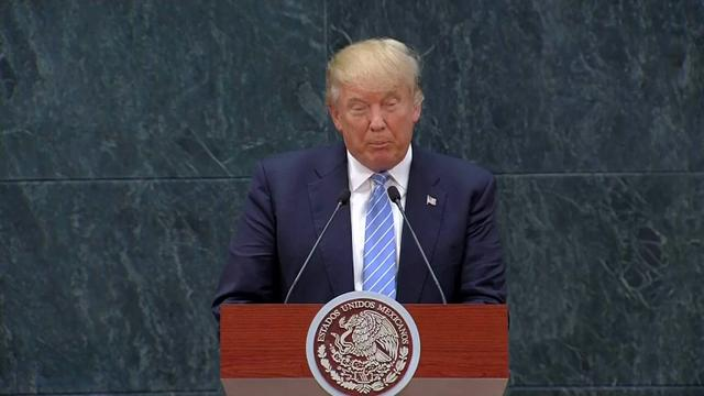 In Mexico, Donald Trump defends border wall
