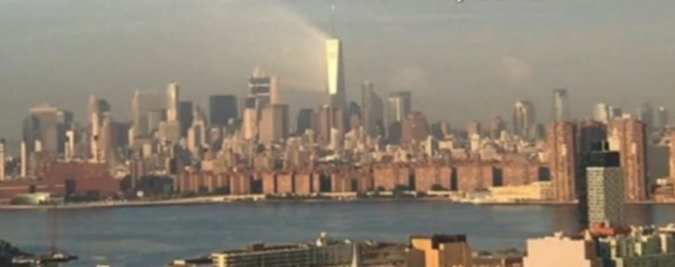 Similar photos of One World Trade approaching 9/11 captured a year apart