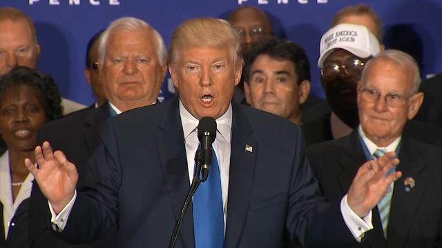 """Donald Trump on Friday addressed the so-called """"birther"""" theory in about 40 words after spending a half hour on an unrelated military tribute and promotion of his new upscale hotel."""